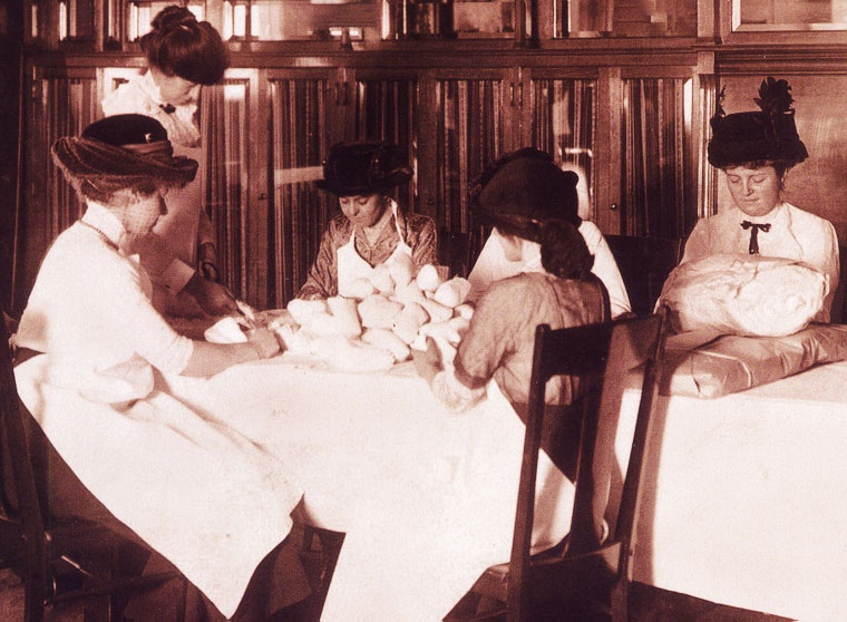 volunteers making gauze rolls- early 1900's.jpg