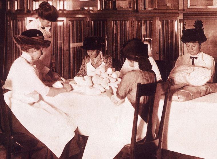 volunteers making gauze rolls- early 1900's.jpg